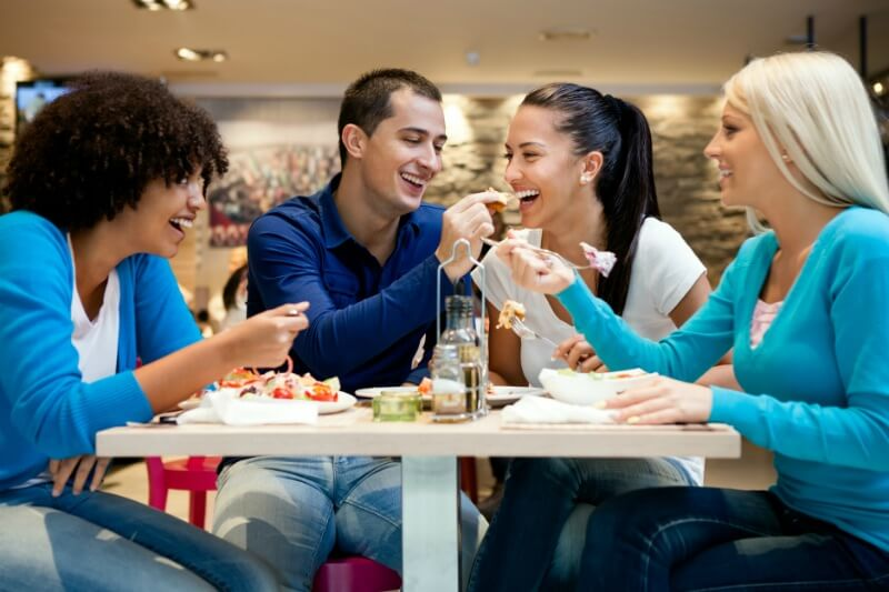 IMG: group of friends enjoying a meal