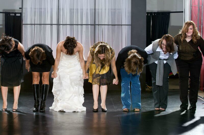 IMG: fashion show participants bowing on stage