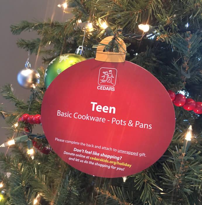 IMG: ornament on tree explaining needs of children for christmas