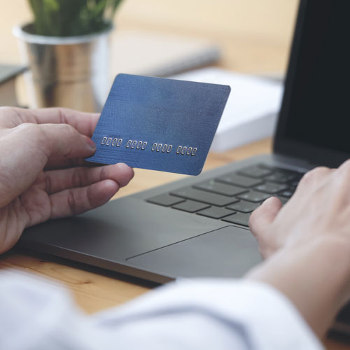 donation payment processing man entering credit card into computer